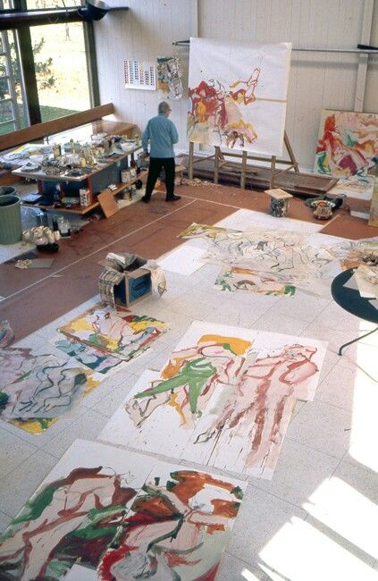 Willem de Kooning painting in his studio